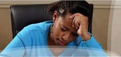 Picture of depressed woman worrying about debts. Chapter 7 bankruptcy can help.